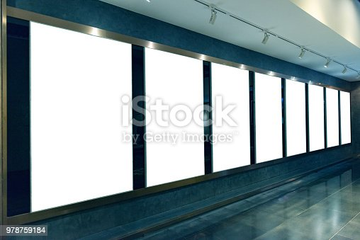 Blank lightboxes on white brick wall