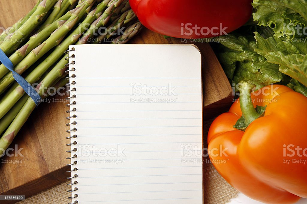 Blank Lined Paper Notebook Surrounded by Veggies royalty-free stock photo
