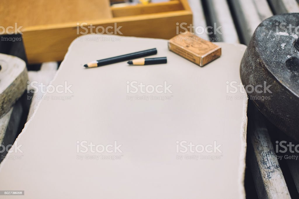 Blank lithographic limestone with crayons stock photo