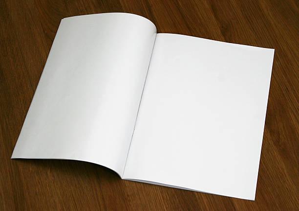 a blank magazine opened on a wooden surface - smeren stockfoto's en -beelden