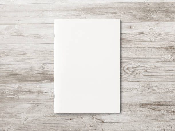 blank magazine or brochure on brown wooden background. front cover top view. mockup concept for your showcase. - magazine cover stock photos and pictures