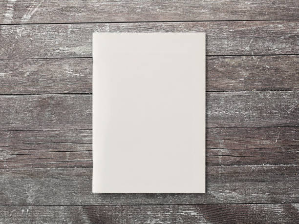 Blank Magazine or Brochure on brown wooden background. Front cover top view. Mockup concept for your showcase. stock photo