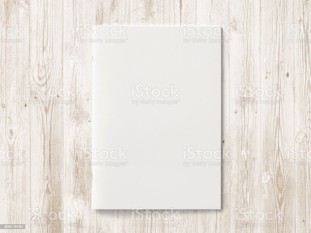 Blank Magazine or Brochure on color wooden background. Front cover top view. Mockup concept for your showcase. stock photo