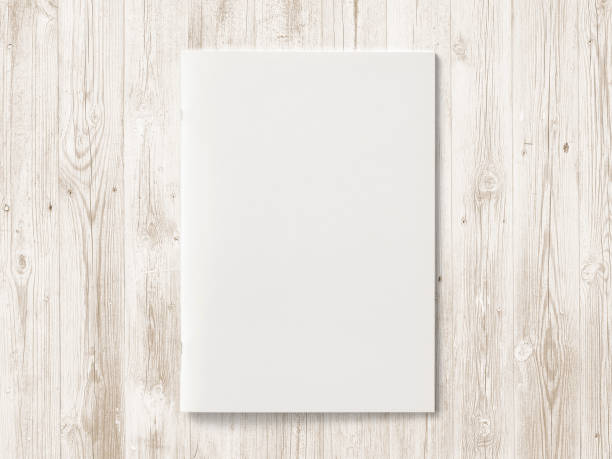 blank magazine or brochure on color wooden background. front cover top view. mockup concept for your showcase. - magazine cover stock photos and pictures