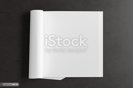 839809942 istock photo Blank magazine page. Workspace with folded magazine mock up on the desk. 1212226635