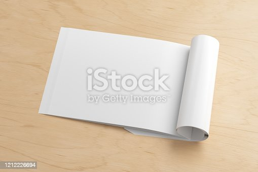 839809942 istock photo Blank magazine page. Workspace with folded magazine mock up on the desk. 1212226694