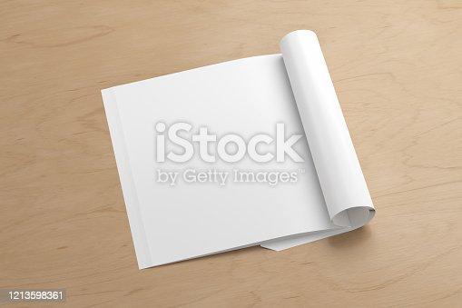 839809942 istock photo Blank magazine page. Workspace with folded magazine mock up on the desk. 1213598361