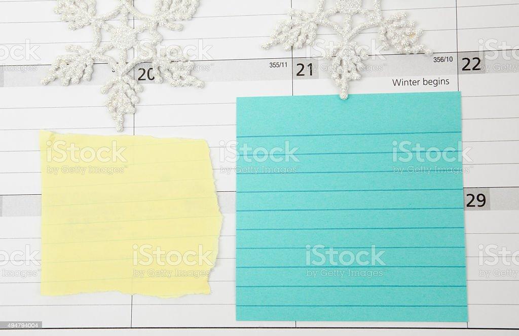 Blank Memo Notes on Winter Calendar stock photo
