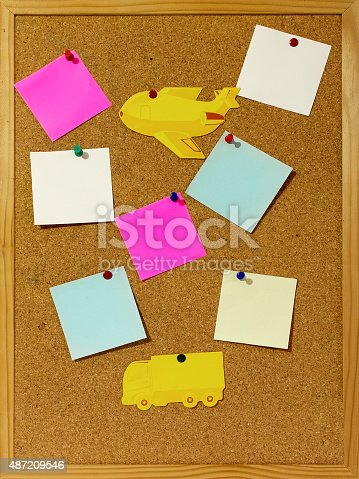 istock Blank memo notes pinned on a cork billboard. 487209546