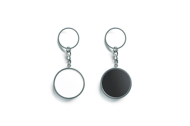 Blank metal round black and white key chain mock up Blank metal round black and white key chain mock up top view, 3d rendering. Clear silver circular keychain design mockup isolated. Empty plain keyring souvenir holder template. Steel trinket label charming stock pictures, royalty-free photos & images