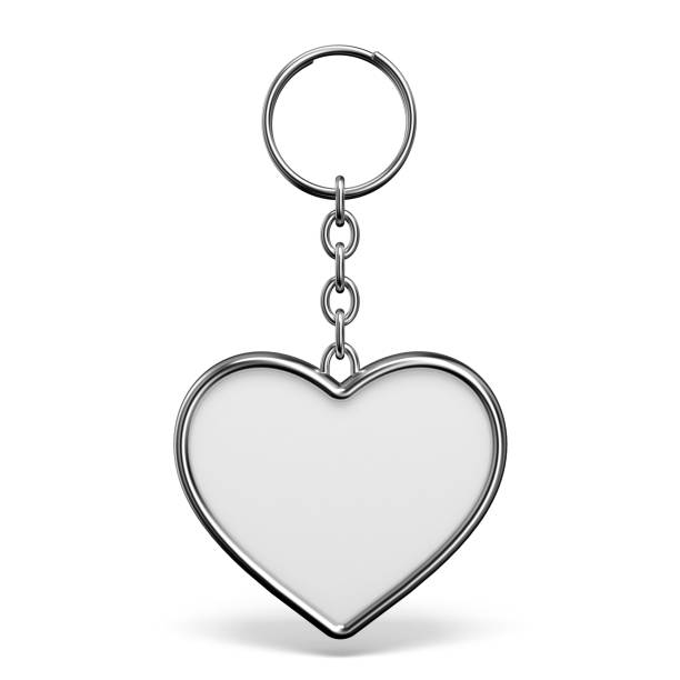 Blank metal trinket with a ring for a key heart shape 3D Blank metal trinket with a ring for a key heart shape 3D rendering illustration isolated on white background amulet stock pictures, royalty-free photos & images