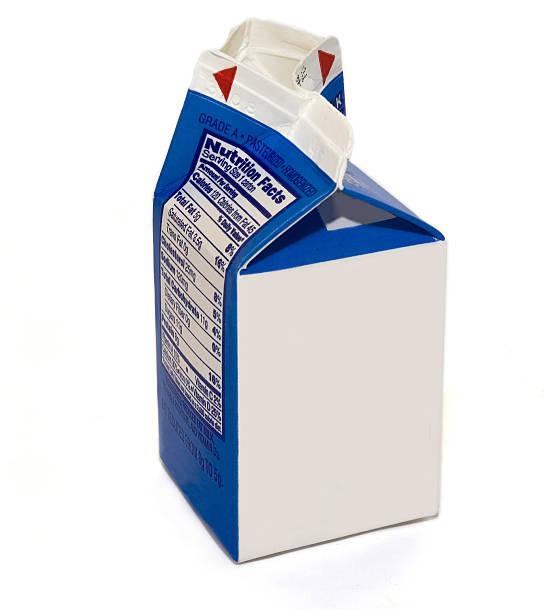 A blank milk carton on a white background stock photo