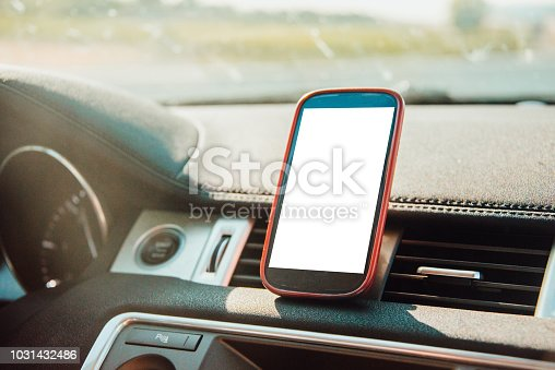 A blank mobile phone screen on a car inside