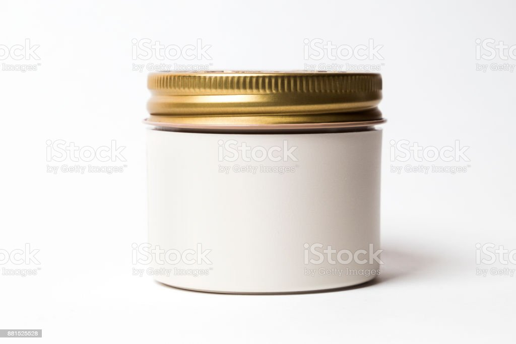 blank mock up advertising with copy space of the white jar with gold cap stock photo