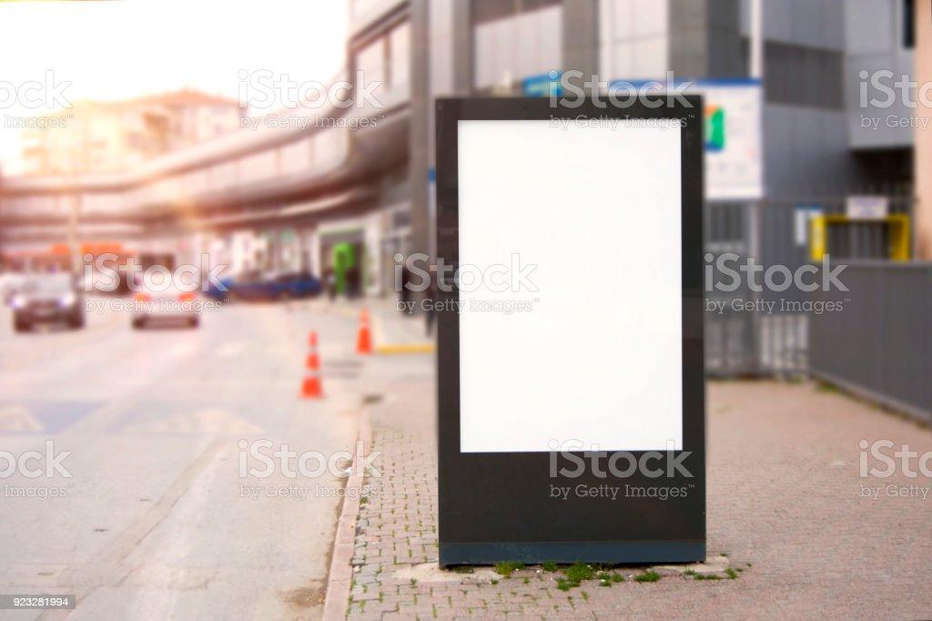 Blank mock up of vertical street poster billboard on bangkok city...