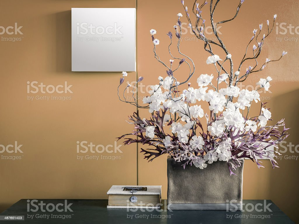 Blank modern interior wall decorate with artificial flowers stock photo