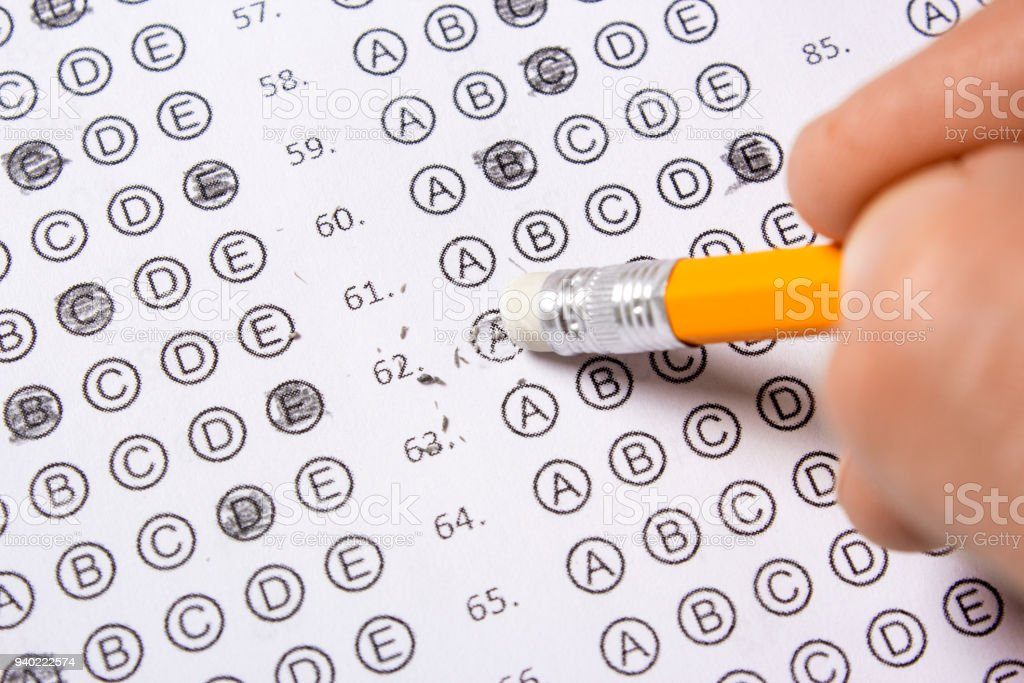 Blank Multiple Choice Answer Sheet Filled With Pencil Correcting The Eraser Royalty
