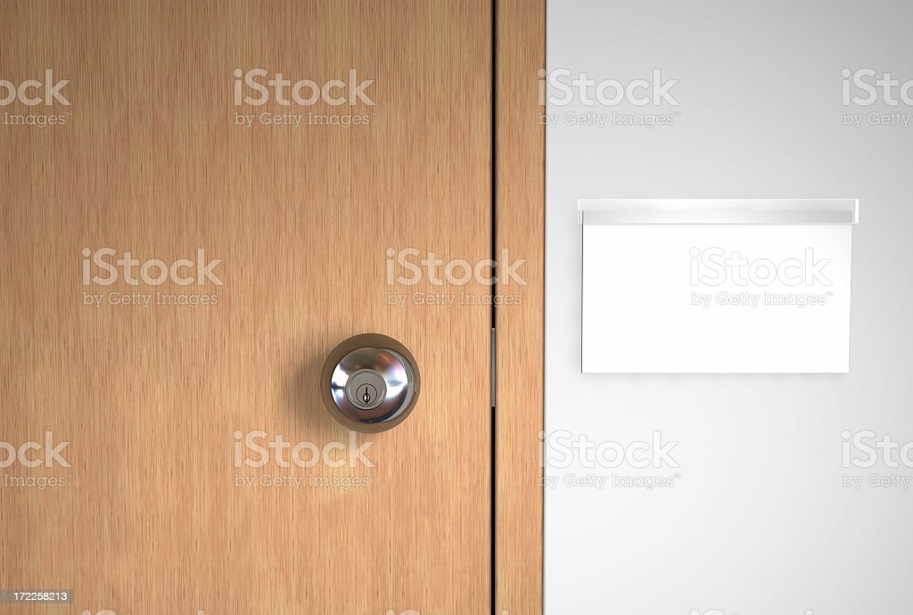 A blank name logo and a stainless door handle on wooden door stock photo