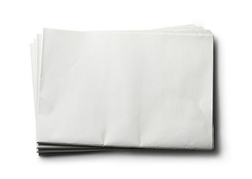 Blank newspaper on white background.