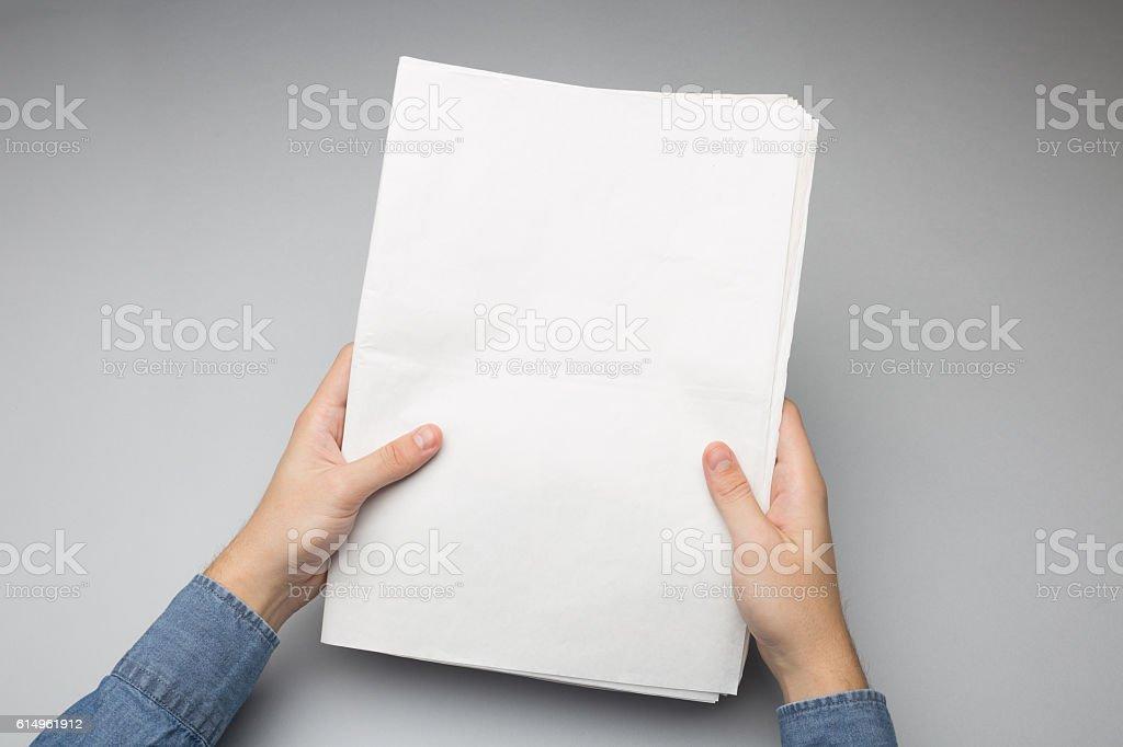 Blank Newspapper Mock-up in hands stock photo