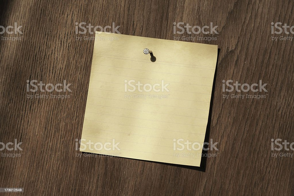 Blank note nailed to wood background royalty-free stock photo