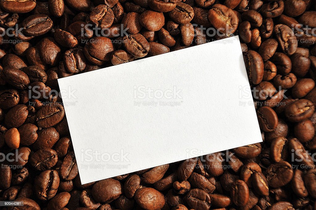 Blank note on coffee beans royalty-free stock photo