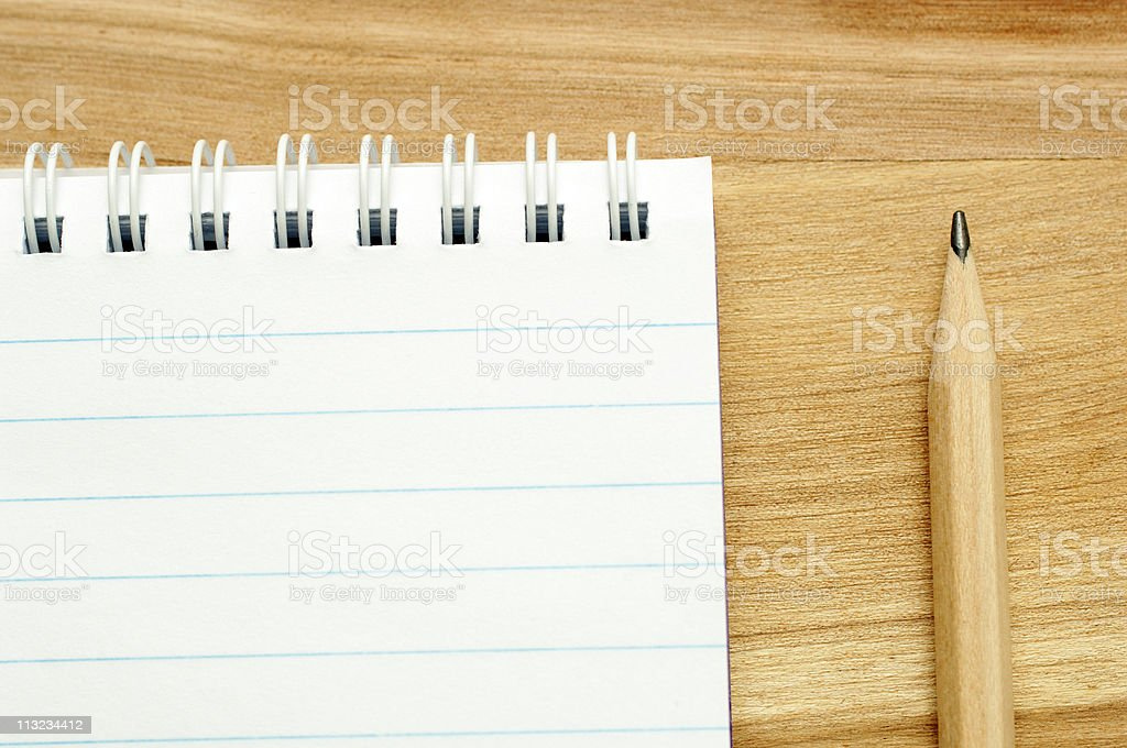 blank note pad and pencil on oak table royalty-free stock photo