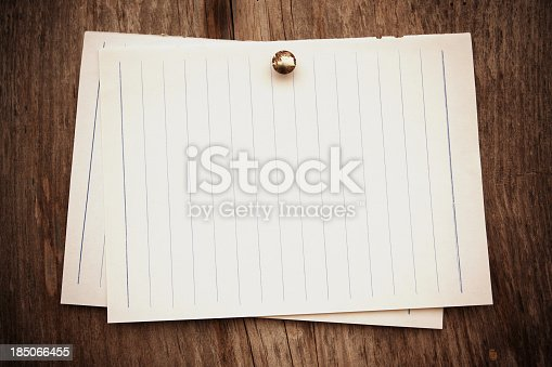 990092558 istock photo Blank note pad paper background textured 185066455