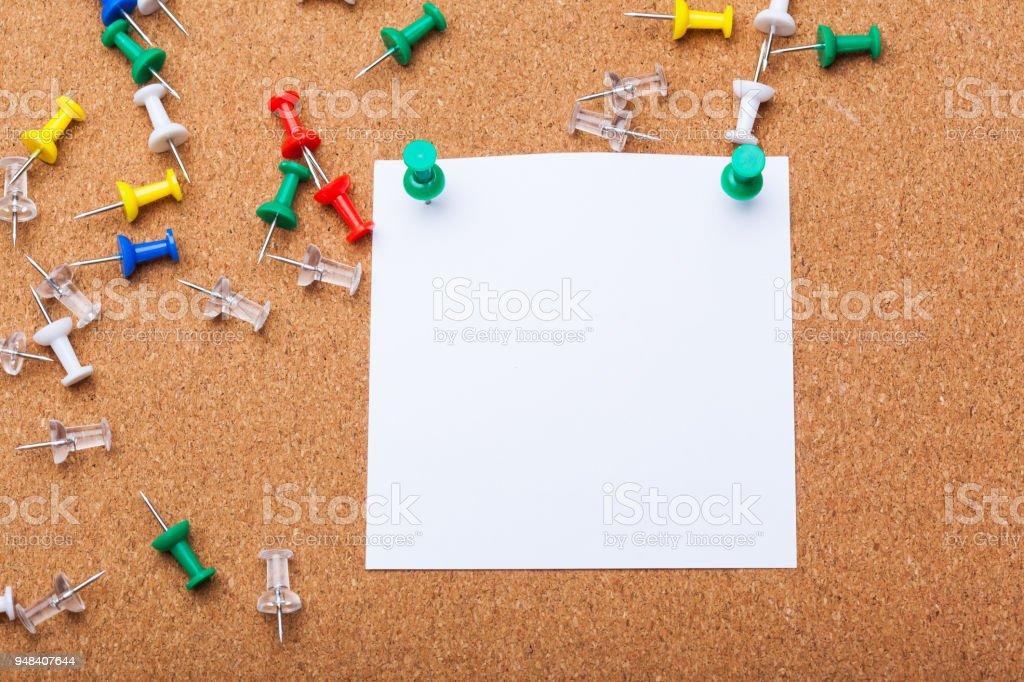 blank note paper on a cork board