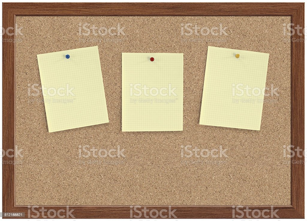 Blank Note Papers Blank yellow note papers pinned on a cork bulletin board with wooden frame. Adhesive Note Stock Photo