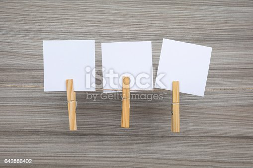1090161334 istock photo Blank note papers tied with clothespins on rope 642886402