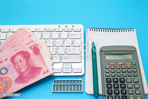 Blank notebook and Calculator on business desktop