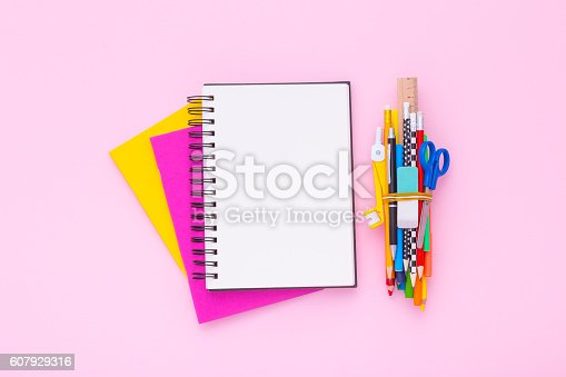 istock Blank notebook on a stack of colorful notebooks. Flat lay. 607929316