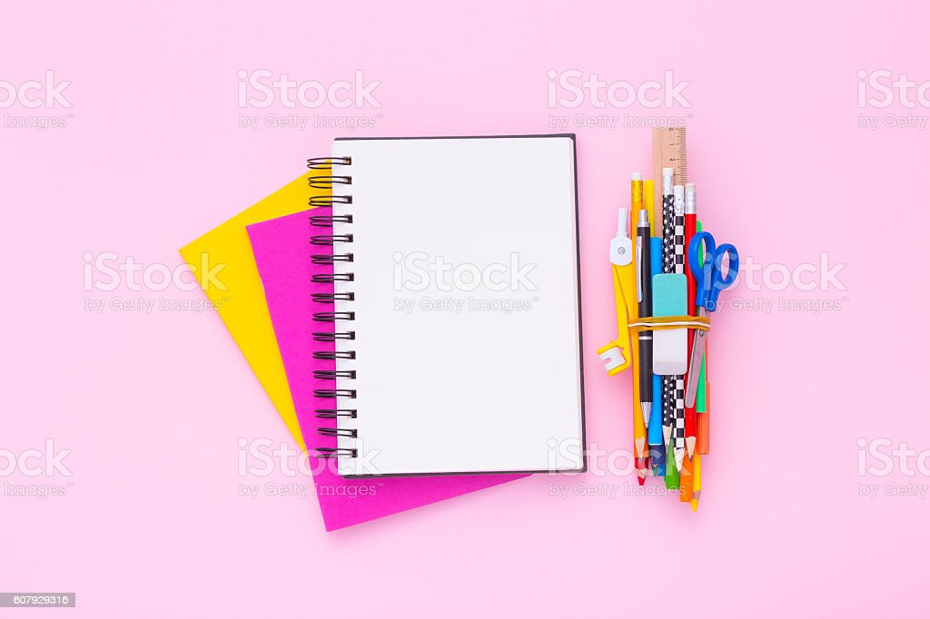 Blank notebook on a stack of colorful notebooks. Flat lay. stock photo