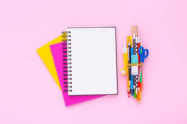 blank notebook on a stack of colorful notebooks. flat lay. - mittelschule bücher stock-fotos und bilder