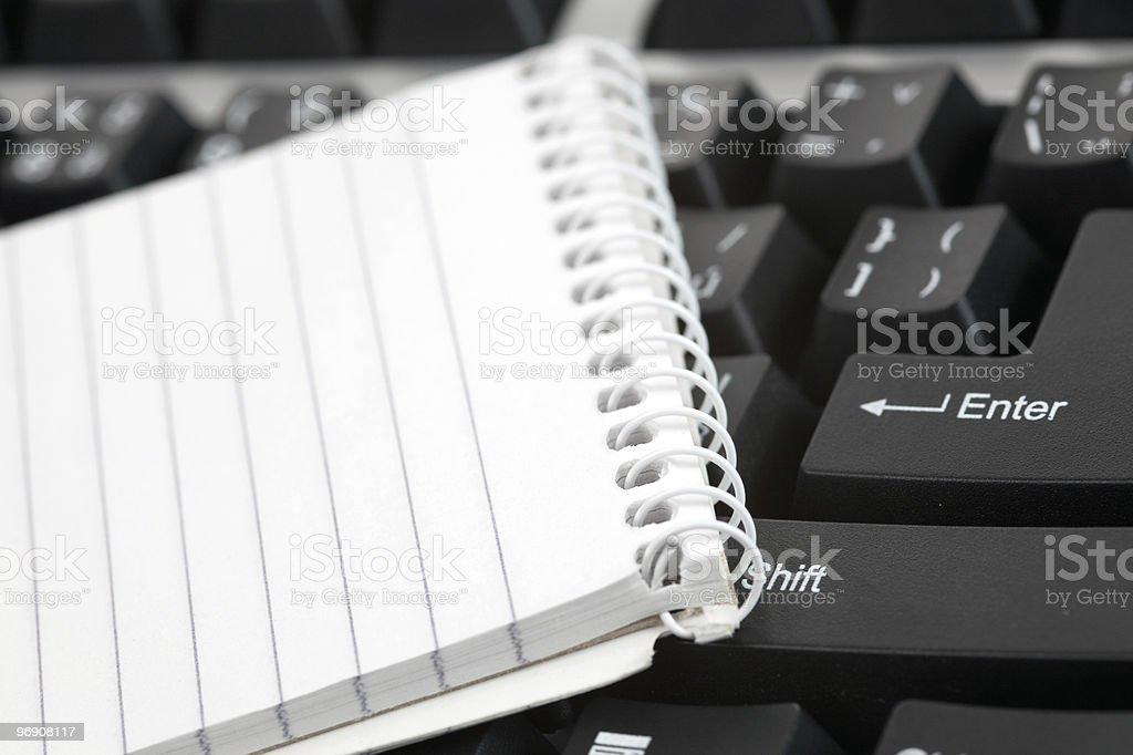 blank notebook on keyboard royalty-free stock photo
