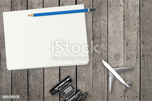 istock Blank notebook on wooden table for travel blogger. 638409428