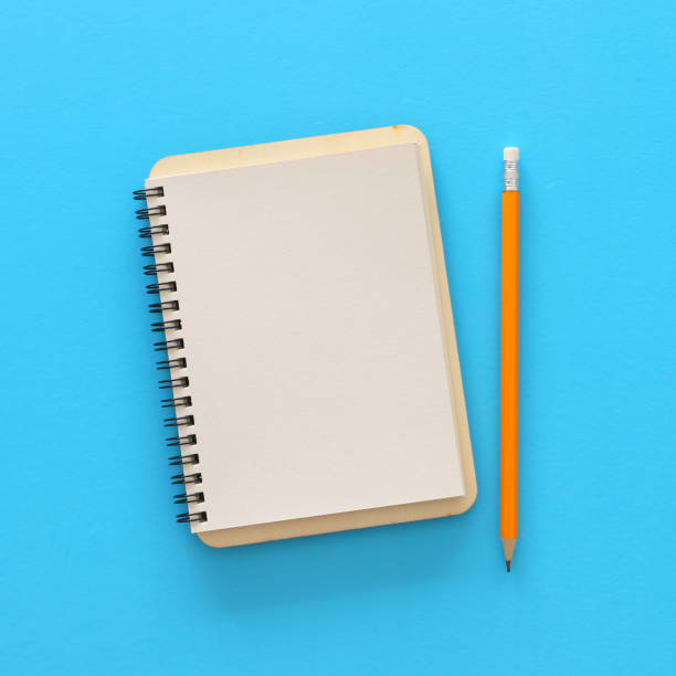 blank notebook over blue background. ready for mockup. Top view flat lay – zdjęcie