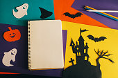 istock blank notebook page on the background Halloween composition 612849560