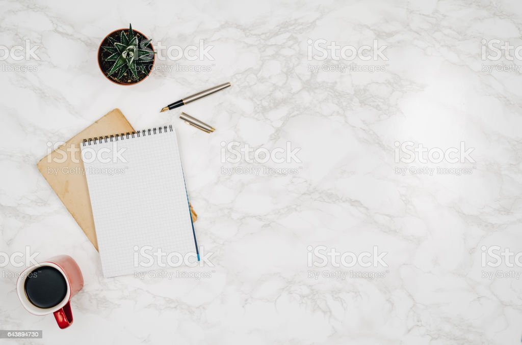 Blank notebook page on white marble table background stock photo