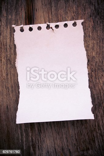 990092558 istock photo Blank Notebook page paper background textured 629761760