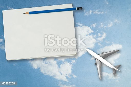 istock Blank notebook page with plan sky travel background 609832094