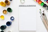 Blank notebook with drawing tools mockup flat lay