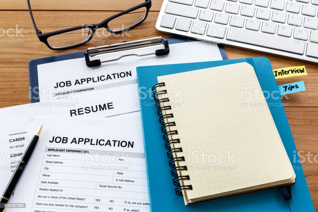Blank notebook with job application stock photo