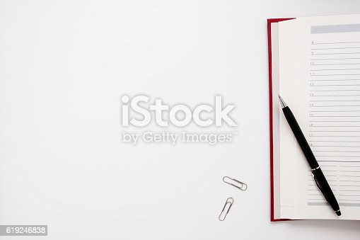 istock Blank notebook with pen and clips free space 619246838