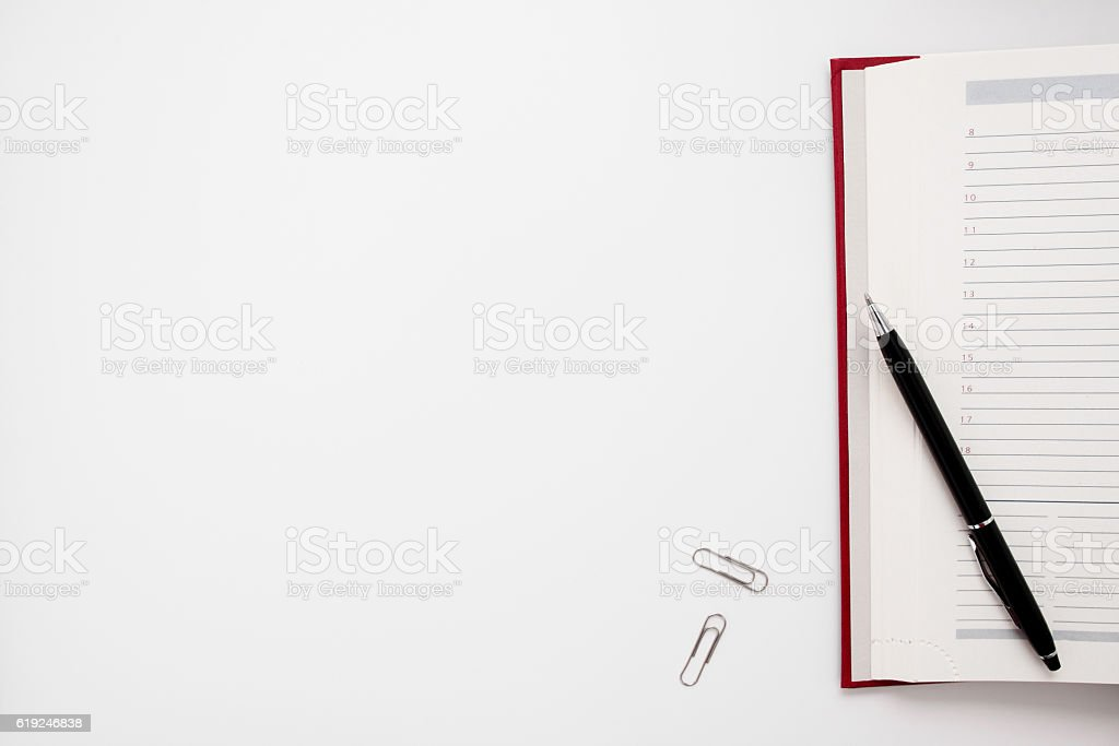 Blank notebook with pen and clips free space stock photo