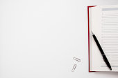 Blank notebook with pen and clips free space