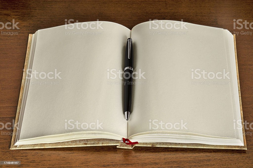 Blank notebook with pen royalty-free stock photo