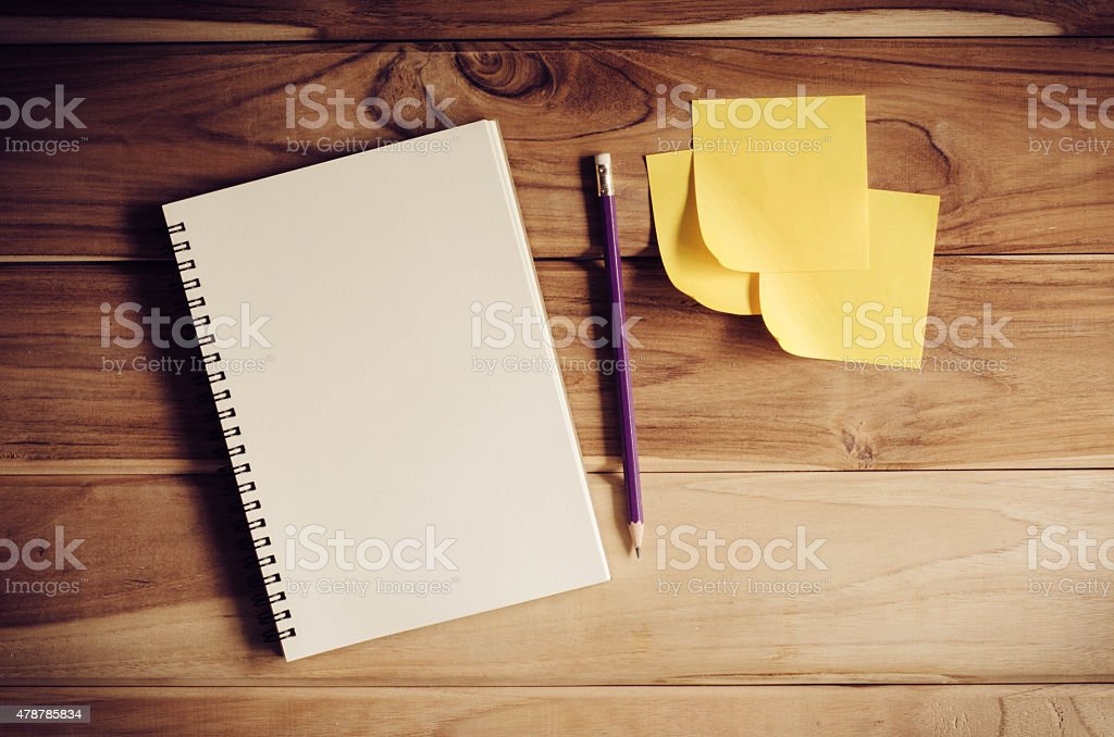 blank notebook with pencil on wooden table - still life - Royalty-free 2015 Stock Photo