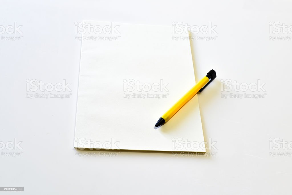 blank notebook with yellow clipboard pen Thailand stock photo